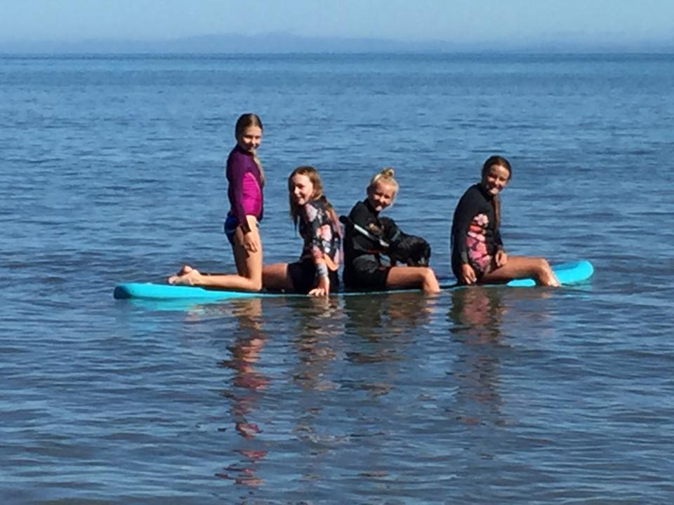 Kids on paddle board